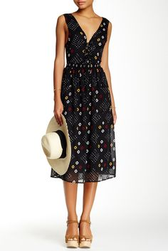 Seriously swooning over this Open Back Midi Dress.
