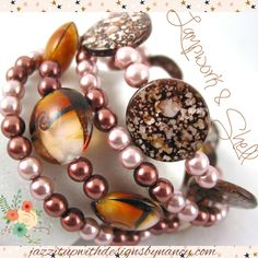 Handmade Bracelet Stack Wrap Brown Black Spotted Shell Lampwork Glass. This is a really unique piece with 3 distinct bands in complimentary color schemes in black, brown, white, copper. The 3 bands create a very unique bangle-like bracelet. Brown spotted shell is exquiste with flecks for Coppery opalescent colors. Glass beads are transparent and have complimentary brown, white, gold and black.