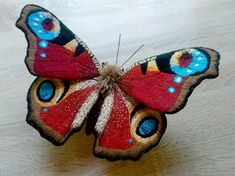 Model [Aglais io] This is a very large butterfly - a textile sculpture. Hand embroidery. Interior decor. 12 inches in height and 18 inches in width of the wings. The sculpture can stand on the surface or hang on the wall. She will decorate any house. Sculpture Aglais io - this is a