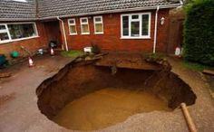 A sinkhole that opened up in the driveway of a house in Walter's Ash, Buckinghamshire