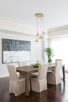 A gorgeous abstract work by artist Celine Ziang sets the dining room apart along with a Ming Dynasty reproduction dining table.