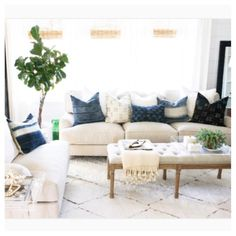 We are digging this gorg living room with a wonderful mix | #indigo #mudcloth #pillows