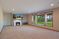 Fireplace: Hemlock mantle and stone tile surround #billjohnsonphotography #greatnwhomes