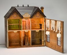 """VICTORIAN DOLL HOUSE, DATED 1884, H 33"""", W 31""""  live auctioneers"""