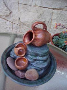 Fuente de agua: Jarra y cuencos