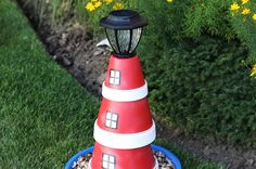 Add Nautical Style To Your Yard With A DIY Flower Pot Lighthouse