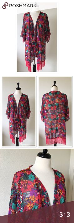 LuLaRoe Monroe Red Floral Duster Large LuLaRoe Monroe duster size large. Deep red with vibrant floral print.   Dime size hole on left shoulder at the seam. See photo.   Only lightly worn a handful of times and only hand washed and hung to dry.  Other than the hole, excellent condition: No other damage or flaws.Your item will be coming from a smoke free home. Our home is cat friendly. LuLaRoe Other