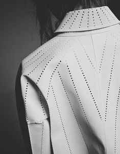 Perforated leather jacket with linear pattern - fabric surface effects; modern textiles; fashion design detail // Issey Miyake