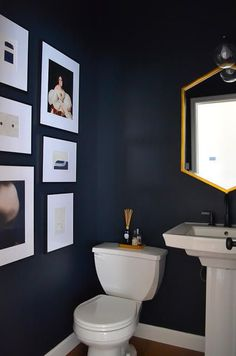 Arin Solange at Home This powder room got a bold makeover with navy paint and gold accessories. Powder Room Storage, Powder Room Paint, Blue Powder Rooms, Powder Room Wallpaper, Modern Powder Rooms, Powder Room Decor, Powder Room Design, Powder Room Mirrors, Small Powder Rooms