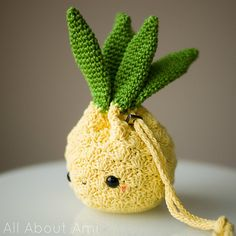Crochet this sweet and adorable pineapple purse to hold your essentials! This functional amigurumi is sure to bring a smile to everyone's faces!