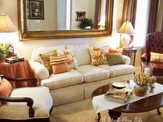 A Large Mirror Over The Couch Brightens The Room.
