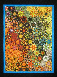 Bibity Bobity Boo!    Like casting a magic spell, this quilt's asymmetry makes for an enchanting design.