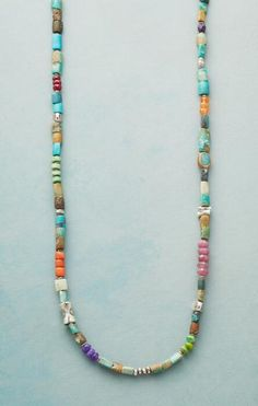 You'll fall in love with the stunning range of hues on our 'Down River' turquoise necklace.
