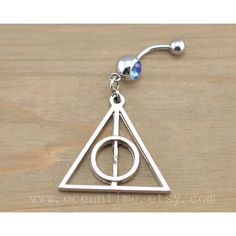 Harry potter Deathly Hallows Belly Button Rings,Navel Jewlery, Harry... (27 PLN) ❤ liked on Polyvore featuring jewelry, piercings, belly button rings, belly rings, dangling jewelry, belly ring jewelry, surgical steel jewelry and belly button rings jewelry
