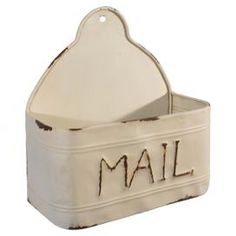 "Keep letters organized with this wall-mount metal mail holder, featuring an antiqued white finish and typographic design.  Product: Mail holderConstruction Material: MetalColor: Antiqued white Features: Wall-mountable Dimensions: 5.2"" H x 12"" W x 4"" D"