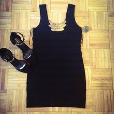 All black sleeve-less dress Dress- worn once , no defects , still in great condition ! Great for the summer season ! Stretchy material . Can fit up to a Xl ! Dresses