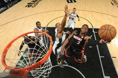 Dwyane Wade goes past Boris Diaw for the Lay up in Game 4 of the 2013 NBA Finals