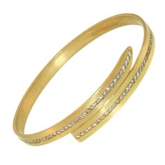 Diamond Wrap Bangle | From a unique collection of vintage bangles at http://www.1stdibs.com/jewelry/bracelets/bangles/