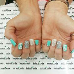 Mint colored nails.