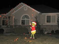 Grinch pulling off the Christmas lights. Good way to do it so you don't have to do the whole house.