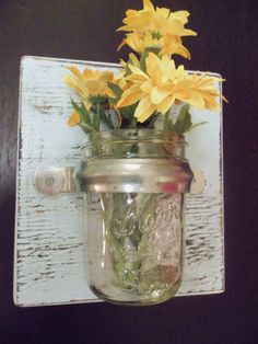 Would be so cute to do with a blue Ball jar, and real or dried flowers...