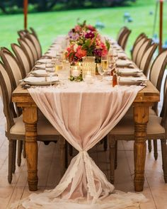 borrowed BLU//tabletop rentals on @marthastewartweddings Each farm table was dressed with soft pink linen and a gauzy white overlay and tied together with white lace trim. The tabletop was set with white candles and gold vases of floral arrangements that mirrored the bridal bouquet.