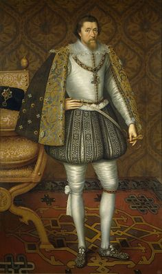 James VI and I, 1603–1610, wears a satin doublet, wired whisk, short cape, and hose over cannions. Narrow points are tied in bows at his waist. He wears the garter and collar of the Order of the Garter.