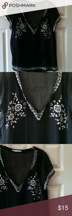 Beautiful Embroidered sheer black peasant top Gorgeous sheer black peasant top with white embroidery....so pretty! Looks amazing with a white or black tank under....approx 28 inches long ....worn once Maurices Tops Blouses