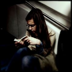 """Girl reading a pocket edition of the """"Divina Commedia"""""""