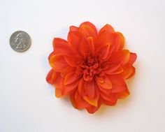 A FLOWER HAIR CLIP FOR THE BRIDE AND BRIDESMAIDS AND FLOWER GIRL! :)