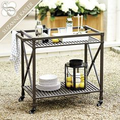 The Suzanne Kasler Directoire Bar Cart is generously sized and sturdily crafted to hold a crowd's worth of glassware, bottles and serving supplies.