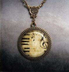 Keyboard and Treble Cleff necklace music by MoonGardenDesigns