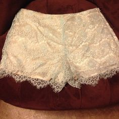 Lace Addie shorts Size large- brand Addie - boutique shorts! Love these, but I'm cleaning the closet out! The lace is a pale pale blue and the silk in line is a champagne color! Super cute! Addie Shorts