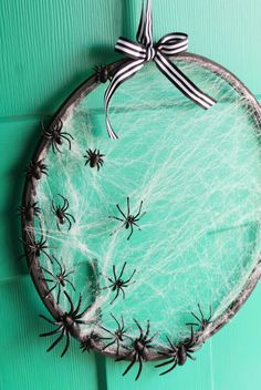 A DIY spider web wreath, made from an embroidery hoop, adds spooky Halloween charm to your front door. Crafts to sell 65 Easy Halloween Crafts You Can DIY to Haunt Your Home This Season Deco Haloween, Soirée Halloween, Adornos Halloween, Easy Halloween Crafts, Holiday Crafts, Homemade Halloween Decorations, Halloween Face Mask, Outdoor Halloween, Halloween Season