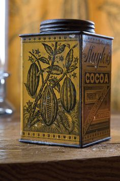 Barry Dixon discovered this vintage cocoa tin in his grandmother's kitchen and used it as the inspiration behind his fabric, Cacao Vine.