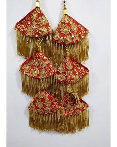 #tassels #fabric #store #collection #tasselscollection #Iatkan #latkans #hanging #blouse #blousehangings #gotawork #gotaworksuit… Lengha Blouse Designs, Salwar Suit Neck Designs, Choli Blouse Design, Saree Tassels Designs, Dress Neck Designs, Bridal Blouse Designs, Diy Jewelry Necklace, Tassel Jewelry, Lehenga Choli Wedding