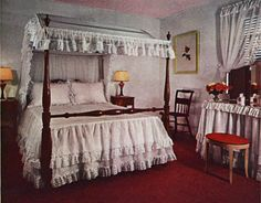 White walls, yards and yards of organdy, pink ceiling, and hunting pink carpet combine wonderfully with colonial maple furniture. This bedroom was completely furnished for $419 in 1942.   - HouseBeautiful.com