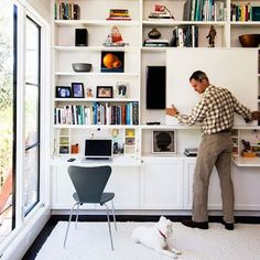 Ideas for a Green Home Remodel The new family room also functions as a home office, thanks to an ingenious floor-to-ceiling media center. A sliding door on the cabinets conceals the TV, and doors fold down into desks. File drawers and a printer station ar Living Room Shelves, Living Room Tv, Kitchen Living, Living Room Without Tv, Tv Escondida, Hidden Tv, Hidden Storage, Tv Storage, Storage Ideas