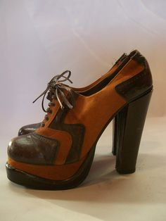 Fantastic 1970s lace up oxford style platforms with chunky, super high heels! Two tone rust soft suede and cocoa brown Spanish leather, open behind leather laces.