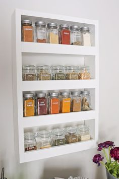 How to build a DIY spice rack that can be mounted on a wall. This wood spice rack will help to organize all your spices, look pretty, and save drawer and closet space since it hangs on the wall.
