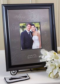 The most exciting trend for wedding guestbook alternatives! These high quality signature frames are made from a beautiful, highly polished silver alloy. When signed with the included, easy to use, non-mechanical Signature Engraving Scribe signatures will last forever and become a treasured conversation piece complimenting any home decor. Signature frames make a great alternative to the traditional paper guest book or the outdated cardboard signing board. Professional engravers will ...