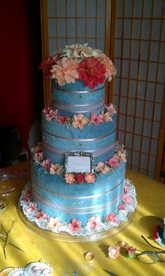 Blue and coral towel cake with Dahlia topper