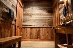 Rustic bathroom with raw edge wooden vanity by Turnipseed Construction