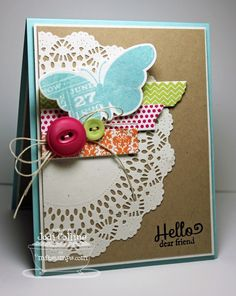 Lovely collage card with doilie and washie tape, button and twine.
