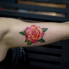 rose tattoo on arm