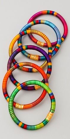 Bohemian bracelets. Love these mixed with metal stacked bracelets. Biddy Craft