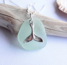 Beautiful seafoam sea glass topped with a sterling silver whale tail.  Hung from a sterling silver chain  Sea glass collected from the beaches along the Ayrshire Coast in the west of Scotland  Sea Glass also known as beach glass and mermaids tears is our lost or broken glass that has found its way to the sea where over many years (often 50 - 200 years) it has been transformed in to beautiful frosted gems by the tumbling action of the tides  Want to add a wee something extra - I can add an…