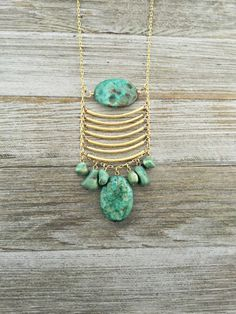 Turquoise And Brushed Gold Tube Bead Necklace by RachaelBartolacci
