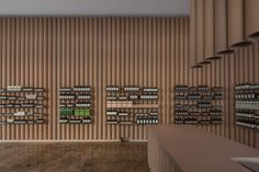 Reclaimed cardboard tubing from fabric rolls used by the nearby fashion district line the walls of this Los Angeles store for skincare brand Aesop.