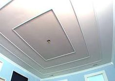 Paint techniques and molding are used to give the illusion of a tiered or vaulted ceiling. Interior Ceiling Design, Pop Ceiling Design, Ceiling Design Living Room, Bedroom Ceiling, Ceiling Trim, Ceiling Detail, Ceiling Beams, Ceilings, Wall Trim